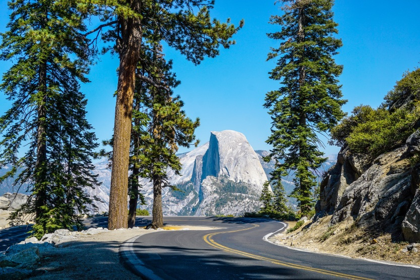Blue skies and open road on the way to Glacier Point in Yosemite National Park, California.